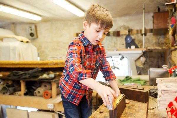Mutlu küçük erkek cetvel atölye Stok fotoğraf © dolgachov