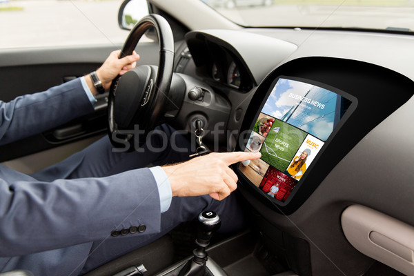 man driving car with news on board computer Stock photo © dolgachov