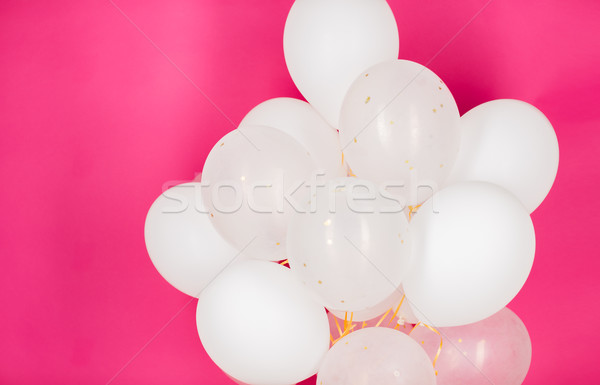 close up of white helium balloons over pink Stock photo © dolgachov