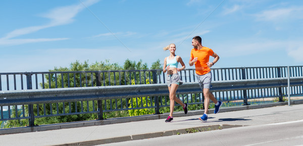 smiling couple running at summer seaside Stock photo © dolgachov