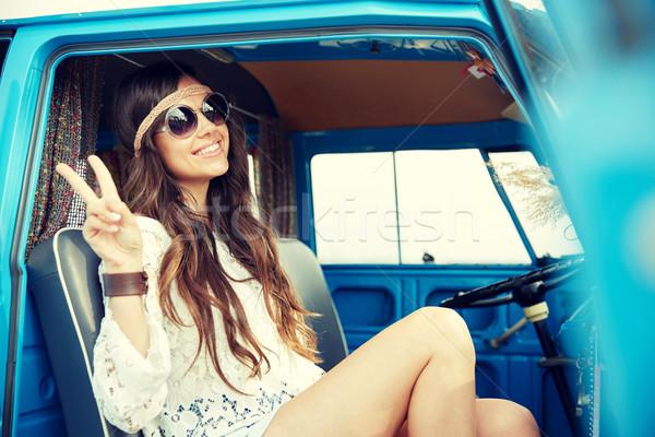 happy hippie woman showing peace in minivan car Stock photo © dolgachov