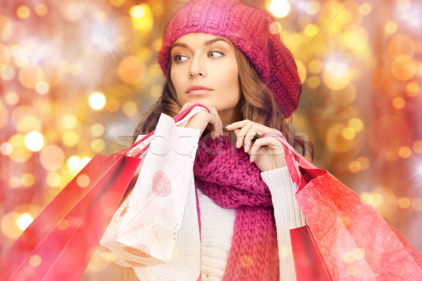 happy woman in winter clothes with shopping bags Stock photo © dolgachov