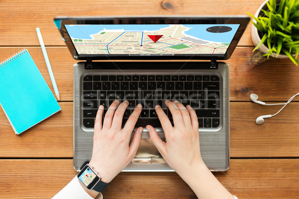 close up of woman with gps navigator map on laptop Stock photo © dolgachov