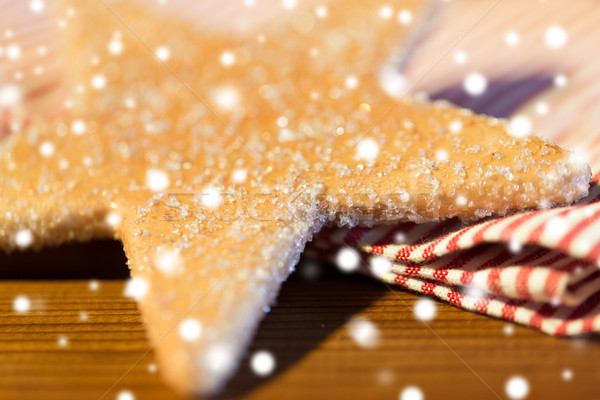 close up of star gingerbread cookie and towel Stock photo © dolgachov