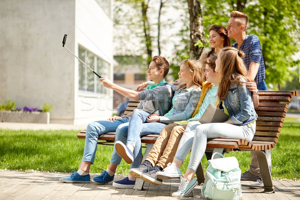 happy teenage students taking selfie by smartphone Stock photo © dolgachov