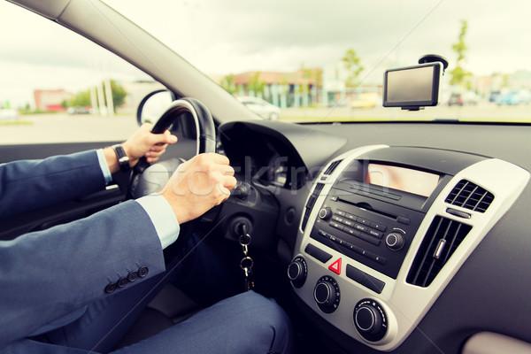 Közelkép fiatalember öltöny vezetés autó szállítás Stock fotó © dolgachov