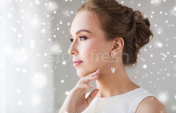 beautiful woman in white with pearl earring Stock photo © dolgachov