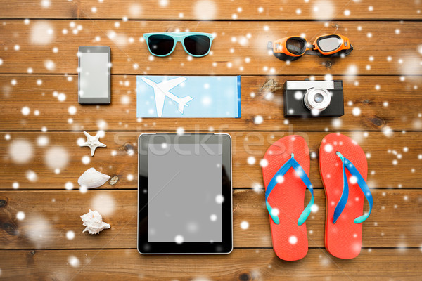 close up of tablet pc and travel stuff Stock photo © dolgachov