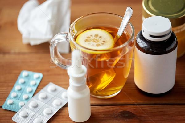 Kubek herbaty narkotyków miodu papieru tkanka Zdjęcia stock © dolgachov