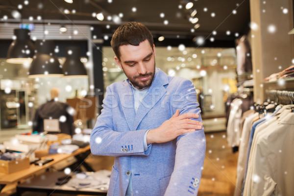 Boldog fiatalember kabát ruházat bolt vásár Stock fotó © dolgachov