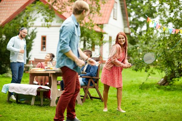Mutlu arkadaşlar oynama badminton yaz bahçe Stok fotoğraf © dolgachov