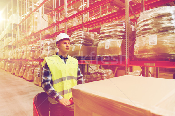 man on forklift loading cargo at warehouse Stock photo © dolgachov