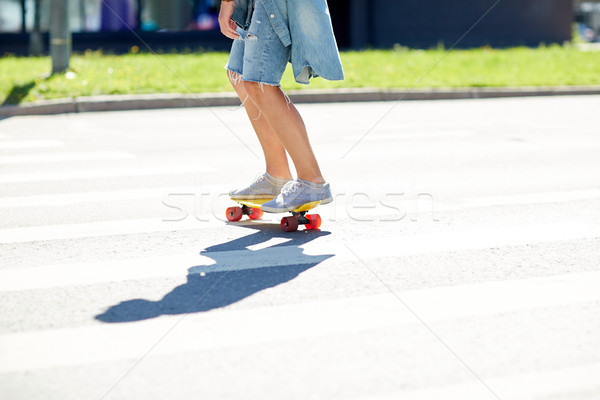 teenage boy on skateboard crossing city crosswalk Stock photo © dolgachov