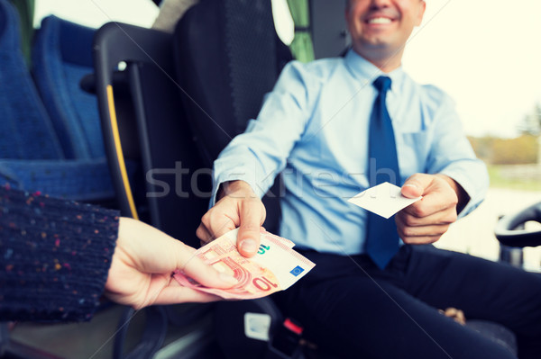 close up of bus driver selling ticket to passenger Stock photo © dolgachov