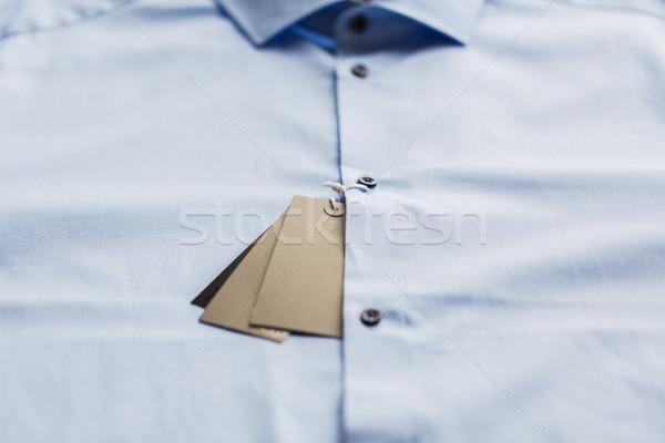 close up of shirt with price tag Stock photo © dolgachov