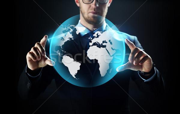 Közelkép üzletember Föld vetítés üzletemberek technológia Stock fotó © dolgachov