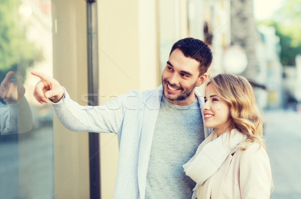 happy couple shopping and looking at shop window Stock photo © dolgachov