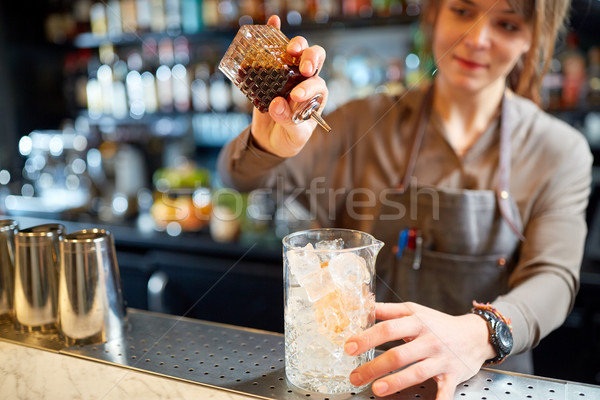 woman bartender preparing cocktail at bar Stock photo © dolgachov