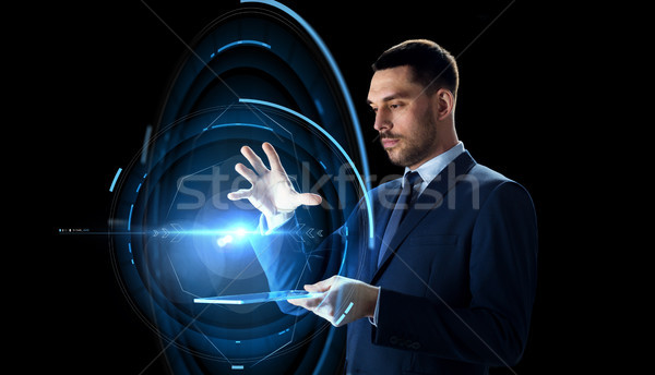 businessman with tablet pc and virtual projection Stock photo © dolgachov