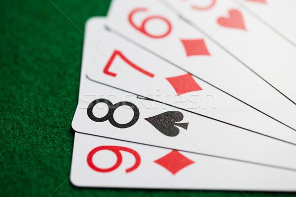 Poker hand speelkaarten groene casino doek Stockfoto © dolgachov