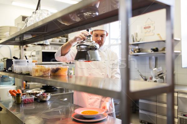 мужчины повар отопления продовольствие лампы кухне Сток-фото © dolgachov