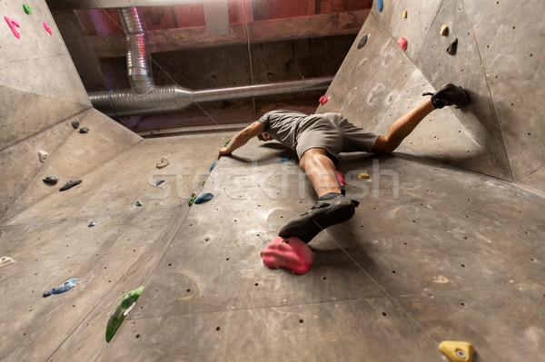 young man exercising at indoor climbing gym Stock photo © dolgachov