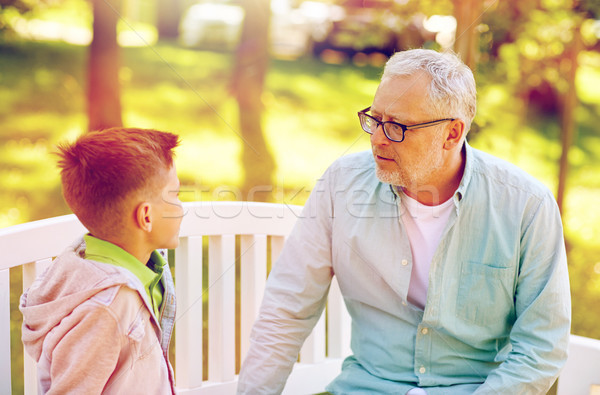grandfather and grandson talking at summer park Stock photo © dolgachov