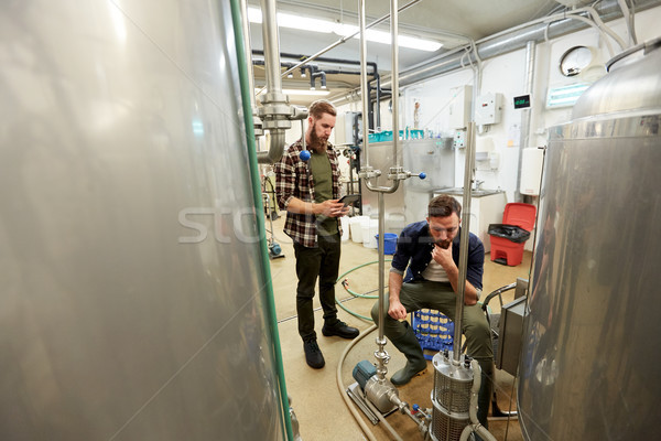 men with tablet pc at craft beer brewery filter Stock photo © dolgachov