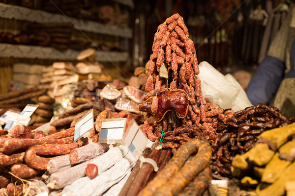 smoked meat products at market or butcher shop Stock photo © dolgachov