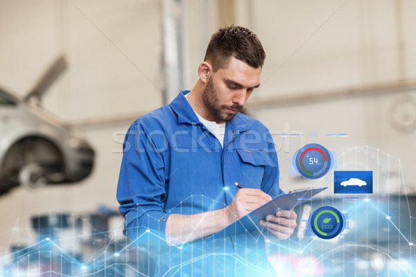 Stock photo: auto mechanic man with clipboard at car workshop