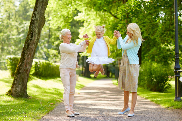Stock photo: happy mother, daughter and grandmother at park