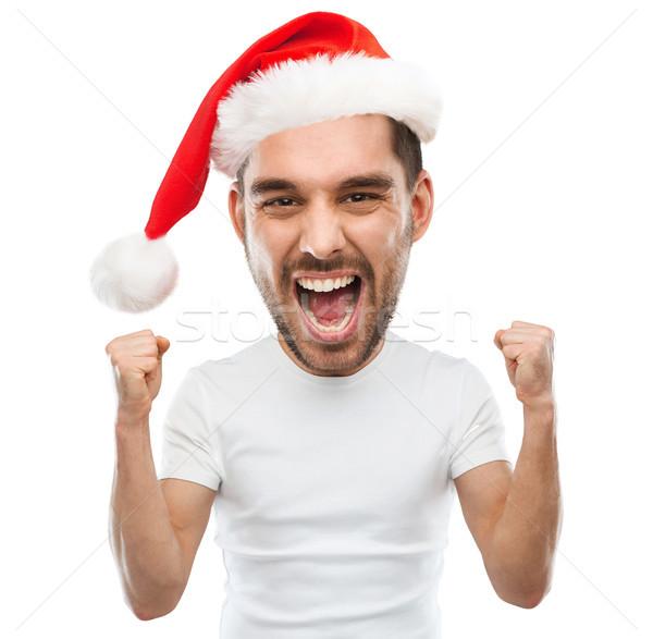 Krzyczeć człowiek Święty mikołaj hat zwycięstwo Zdjęcia stock © dolgachov