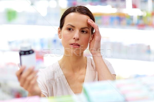 customer with headache choosing drugs at pharmacy Stock photo © dolgachov