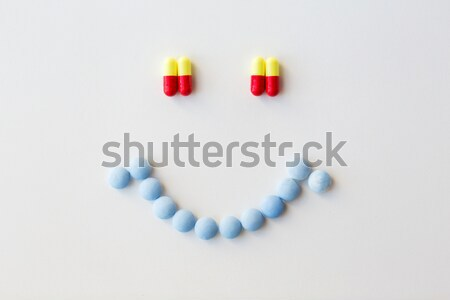 smiley of different pills and capsules of drugs Stock photo © dolgachov