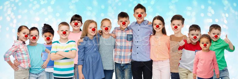 happy children hugging at red nose day Stock photo © dolgachov