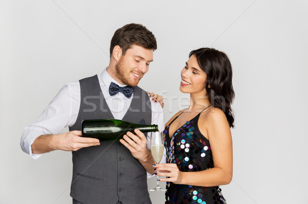 happy couple with champagne and glass at party Stock photo © dolgachov