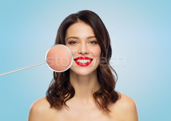 beautiful woman with magnified smooth facial skin Stock photo © dolgachov
