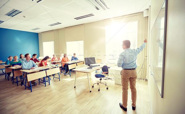 students and teacher at school white board Stock photo © dolgachov