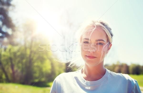 happy young volunteer woman outdoors Stock photo © dolgachov