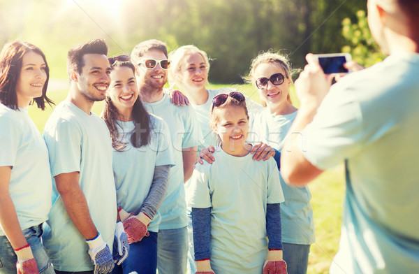 Stock photo: group of volunteers taking picture by smartphone
