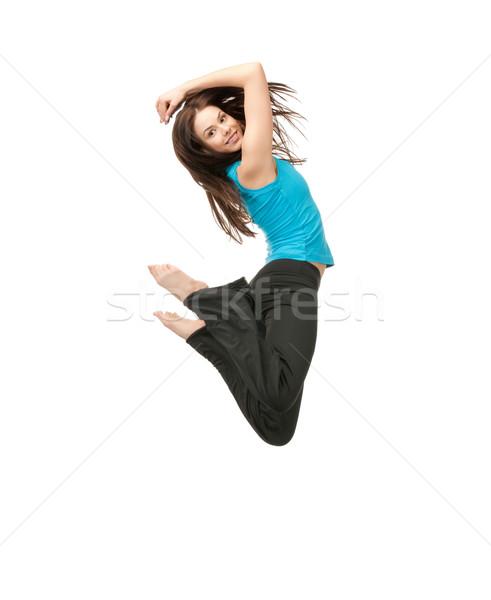 Saltando menina brilhante quadro feliz Foto stock © dolgachov