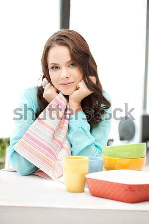 lovely housewife at the kitchen Stock photo © dolgachov