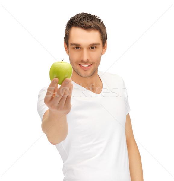 Man witte shirt groene appel knappe man Stockfoto © dolgachov