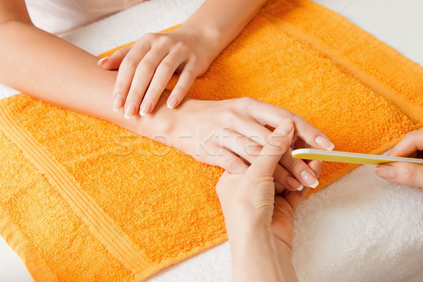 manicure process on female hands Stock photo © dolgachov
