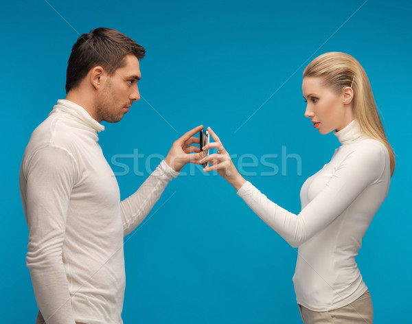 man and woman with modern gadgets Stock photo © dolgachov