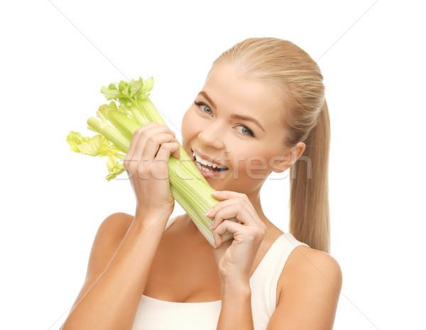 Nő harap darab zeller zöld saláta Stock fotó © dolgachov