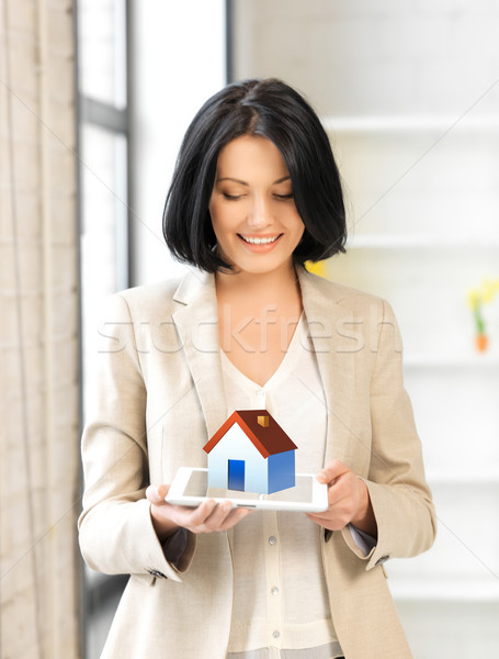 woman holding tablet pc with house illustration Stock photo © dolgachov