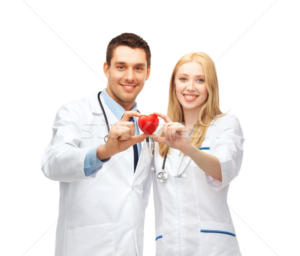 doctors cardiologists with heart Stock photo © dolgachov