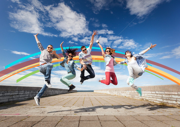 Stock photo: group of teenagers jumping