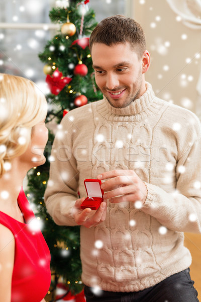 romantic man proposing to a woman Stock photo © dolgachov